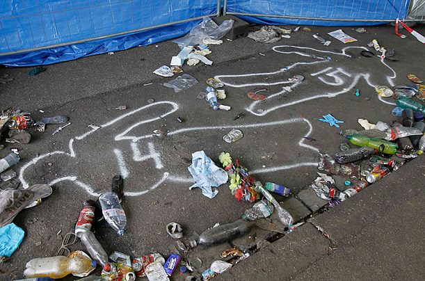 victims 14 and 15 of a deadly stampede are marked on the street between two tunnels in Duisburg. At least 19 people were killed in a stampede at the