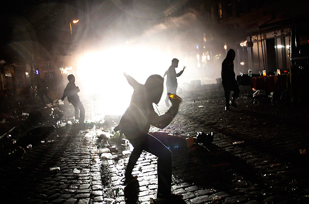 Rioters clash with police after a street party in Hamburg, Germany