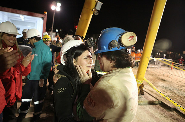 Osman Araya embraces his wife, as he becomes the sixth miner to exit the rescue capsule, from the San Jose mine near Copiapo, Chile. All 33 trapped miners made it back to the surface after