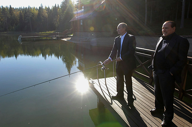 Russian Prime Minister Vladimir Putin fishes with his Italian counterpart Silvio Berlusconi in the Saint Petersburg region.