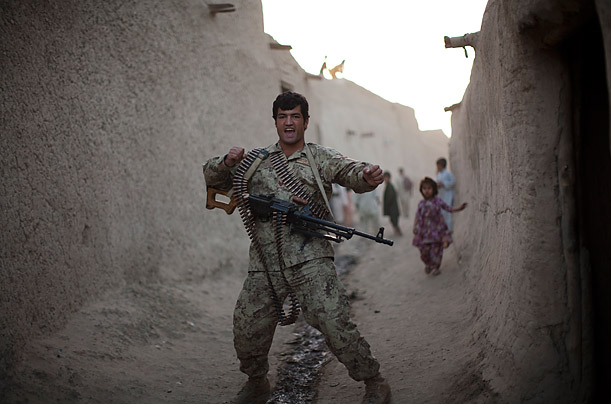 An Afghan policeman attached to an American unit poses for his picture during a patrol in Kandahar City.