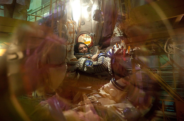 European Space Agency astronaut Paolo Angelo Nespoli sits inside Soyuz TMA-20 spacecraft in the assembling hangar at the Baikonur cosmodrome in Russia.