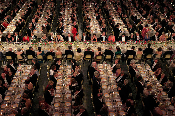 Guests dine during the Nobel Banquet at the Stockholm Town Hall.  Every year since 1901 the Nobel Prize has been awarded in Sweden for achievements in physics, chemistry, physiology or