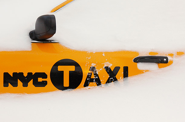 A Taxi is buried in a snow drift after a severe winter storm dropped around two feet of snow on the greater New York area.