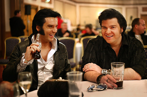 Two Elvis tribute artists sit together during the European Elvis Championships at the Hilton Hotel in Birmingham, England.  Eighty contestants are taking part in three days of