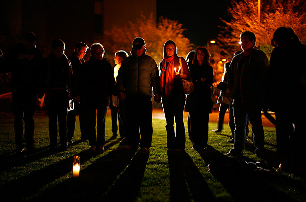 People attend a candlelight vigil held at the Tucson University Medical Center after U.S Representative Gabrielle Giffords was shot in Arizona.
