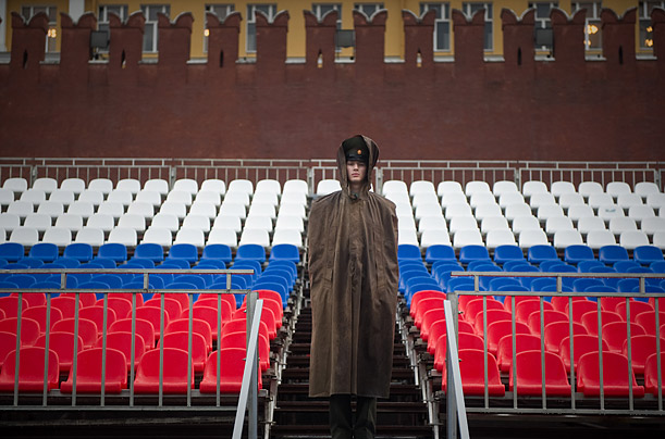 A Russian soldier waits for a Victory Day military parade rehearsal following heavy rain on Red square in Moscow. The parade, which commemorates the 1945 defeat of Nazi Germany, will take plac
