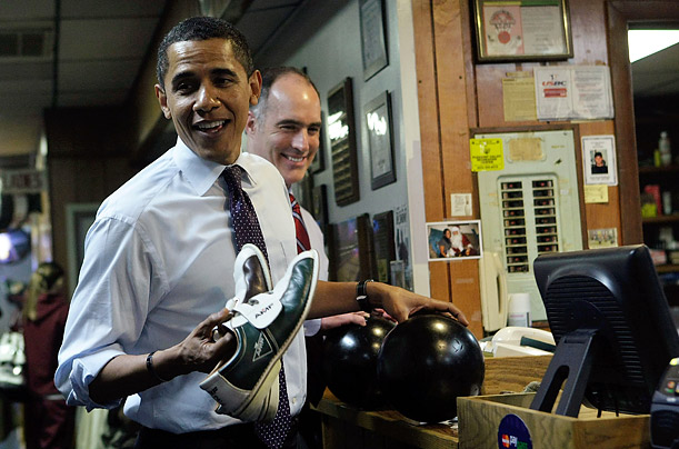Democratic presidential hopeful Barack Obama, left, and Pennsylvania Senator Bob Casey pick up their bowling balls and shoes at a bowling alley in Altoona, Pennsylvania.